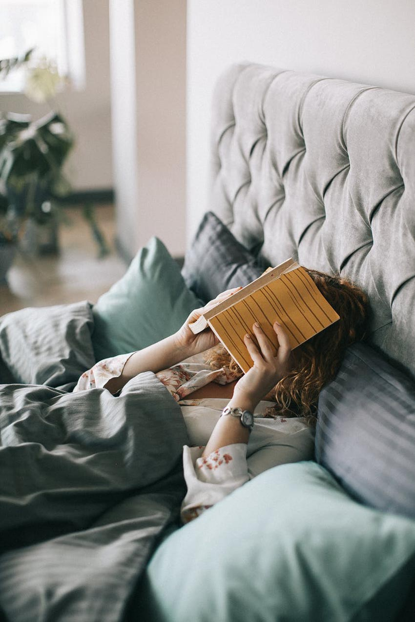 woman tired book reading exhausted lifestyle